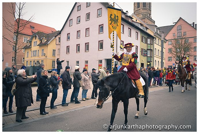 A horse rider carrying the town colours