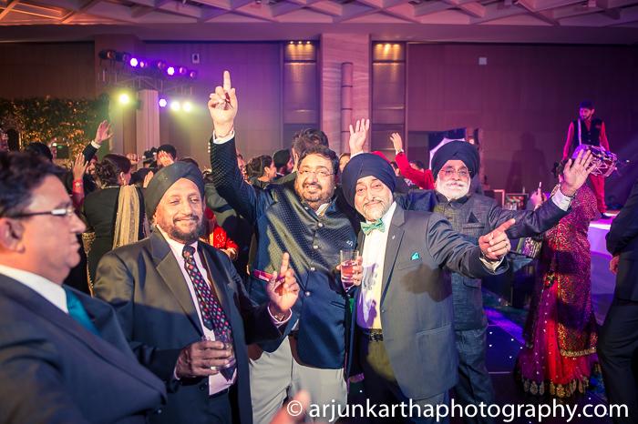 Arjun-Kartha-Candid-Wedding-Photography-Gulveen-Angad-86