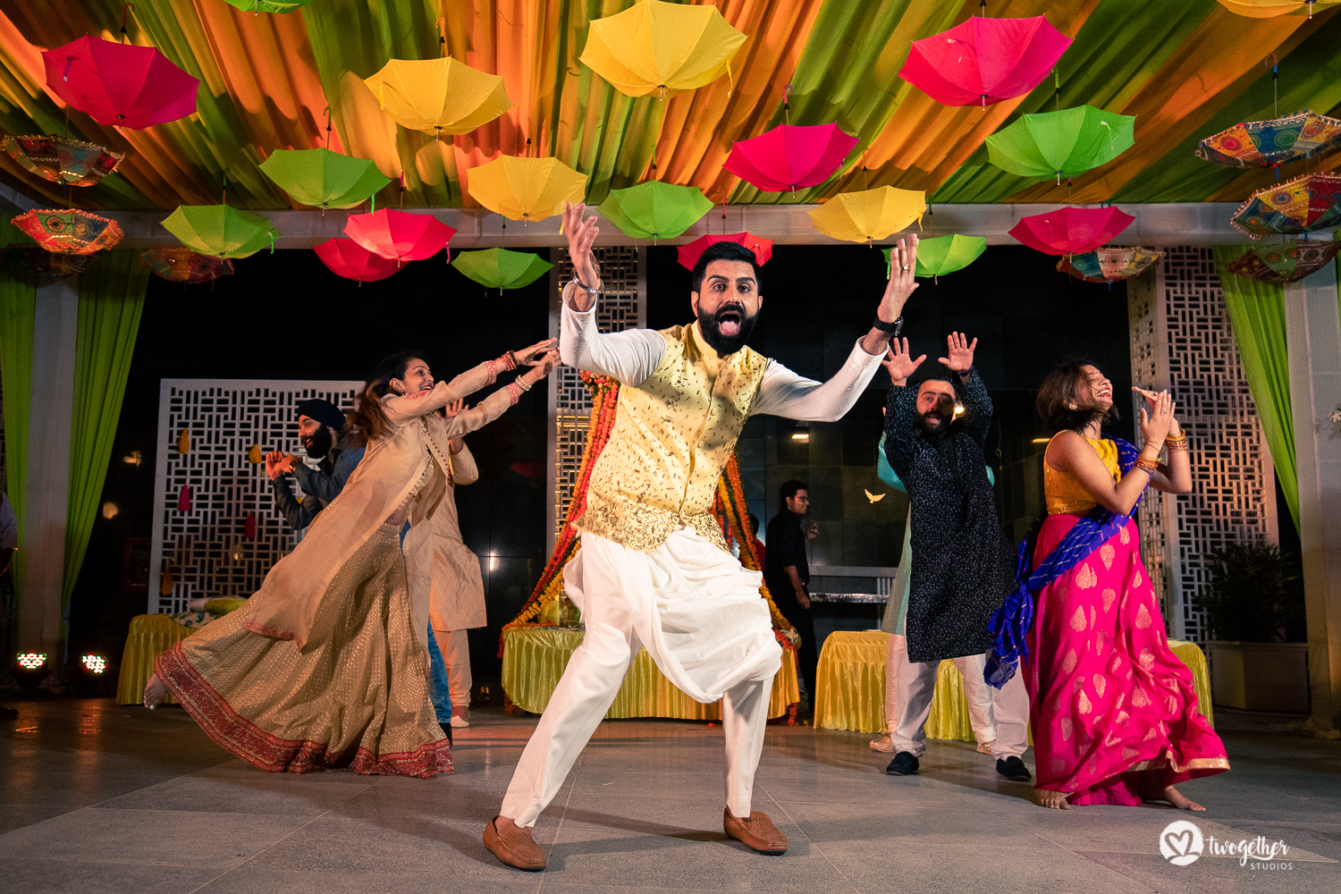 Indian groom dancing at a Delhi wedding.
