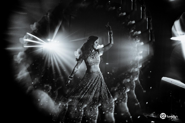 Indian bride dancing at her sangeet in Bangkok destination wedding.