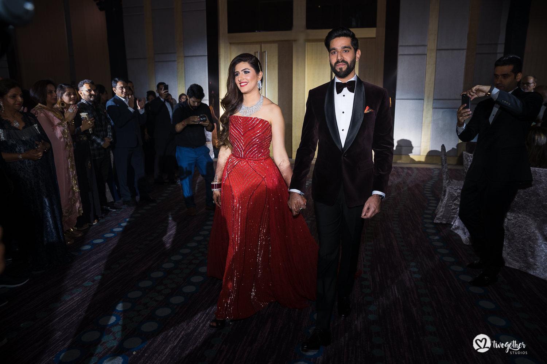 Indian couple enter their reception at Bangkok destination wedding.