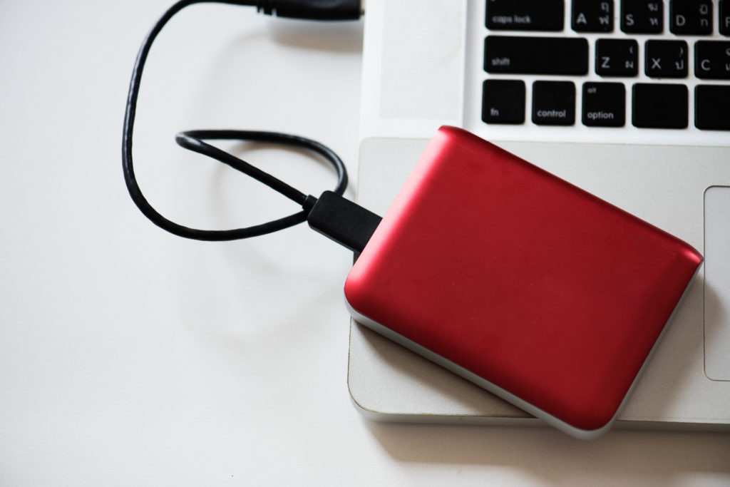 Storage drive connected to a laptop. Stock image for Covid 19 lockdown blog.