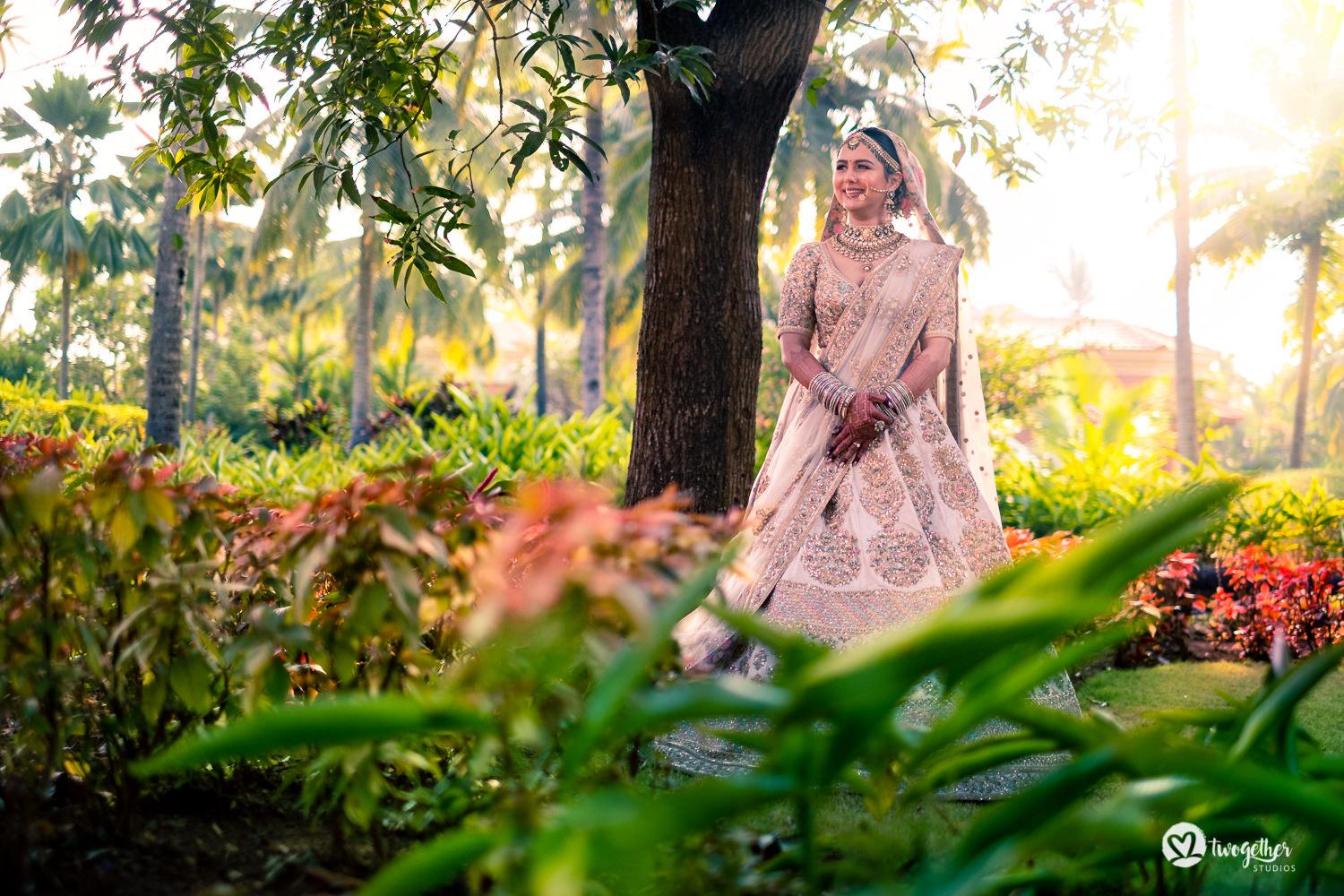 Indian bride in Sabyasachi lehenga for Goa destination wedding