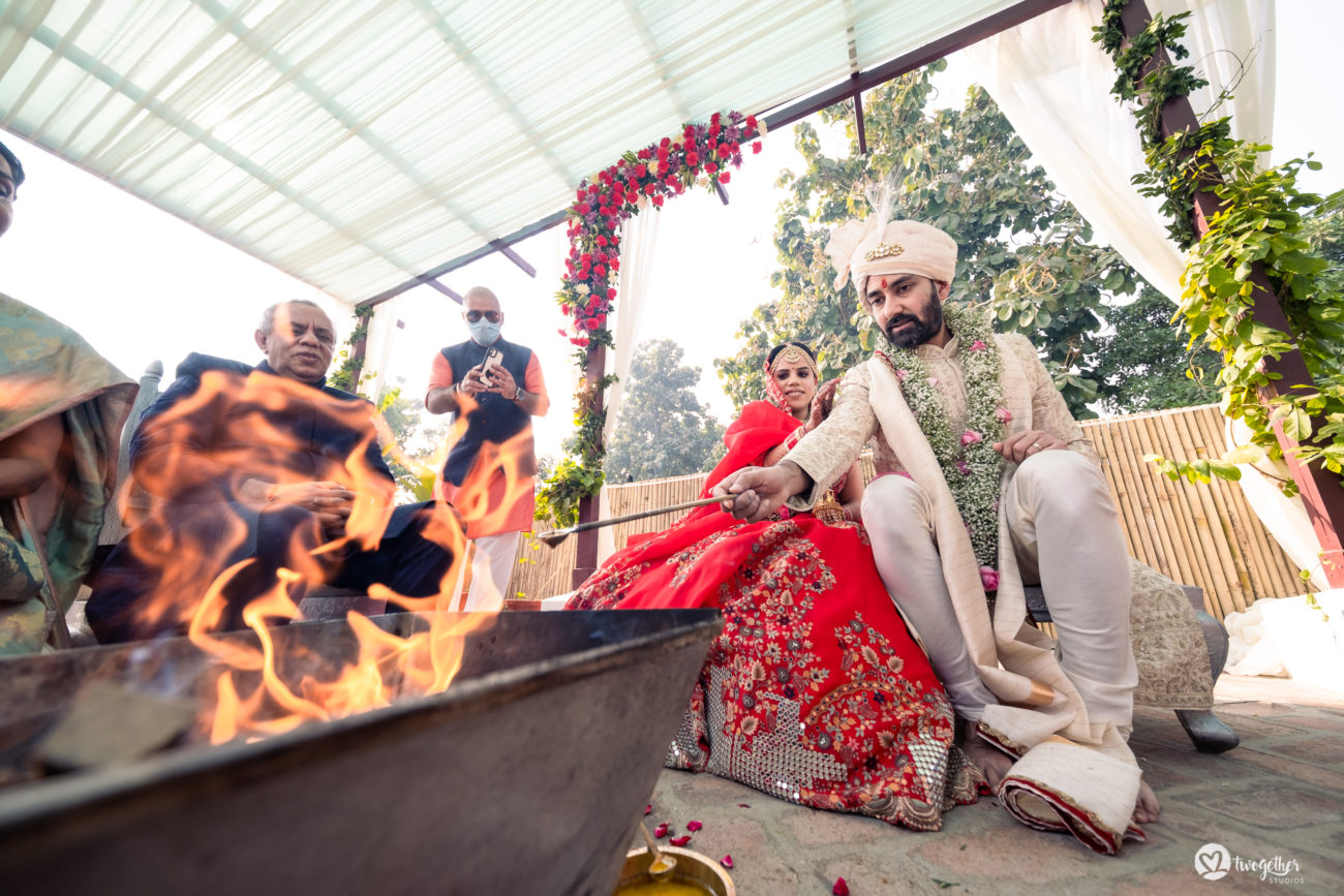 Couple in the mandap in an intimate wedding.