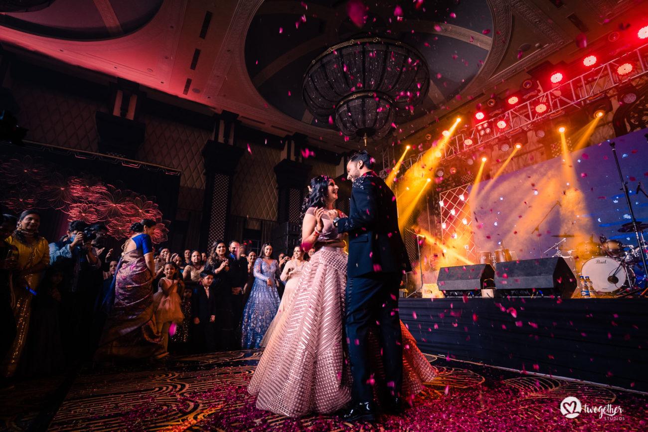 Couple dance in an ITC Grand Bharat wedding.