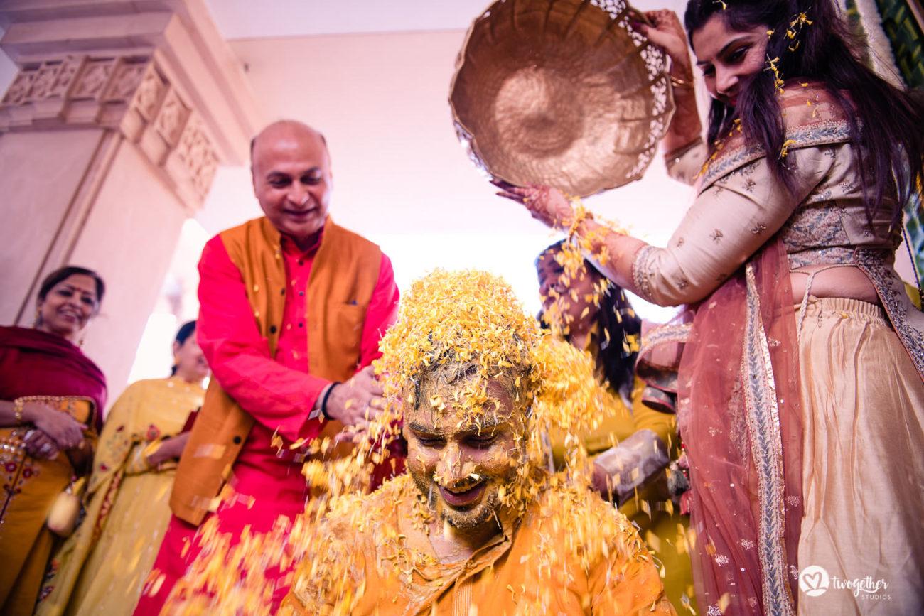 Groom haldi in an ITC Grand Bharat wedding.