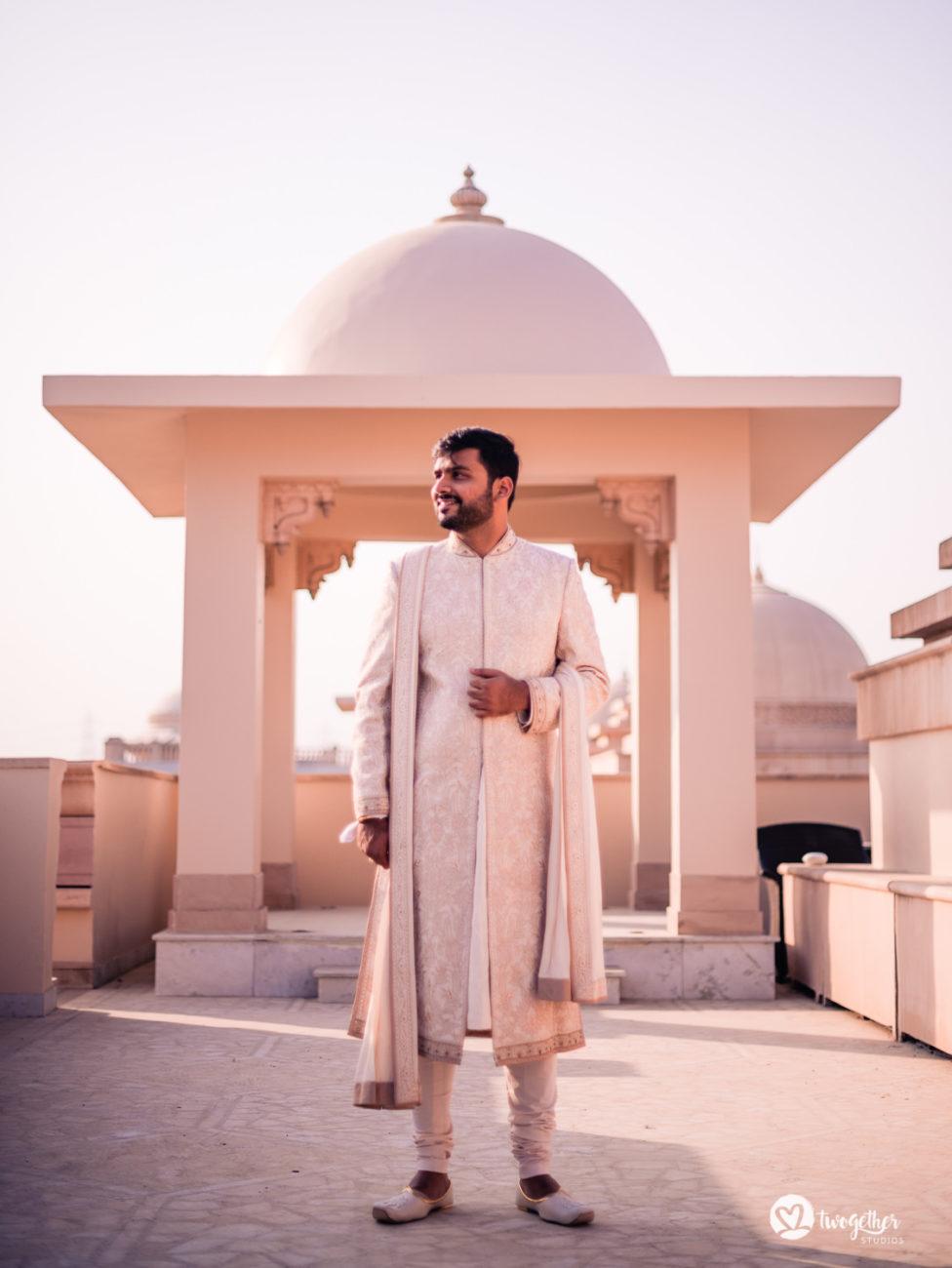 Indian groom in a Tarun Tahiliani Sherwani in an ITC Grand Bharat wedding