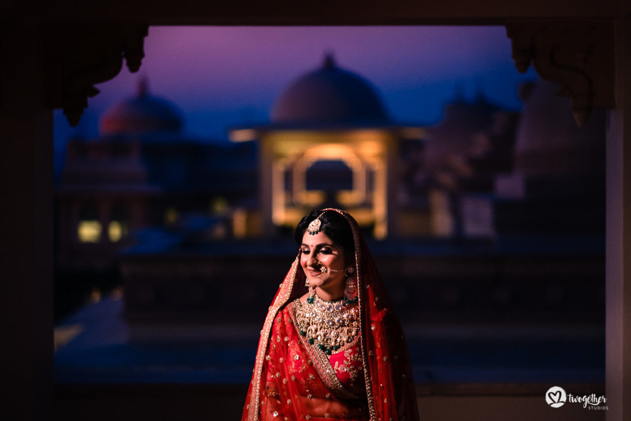 Indian bride in a red Sabyasachi lehenga in an ITC Grand Bharat wedding.