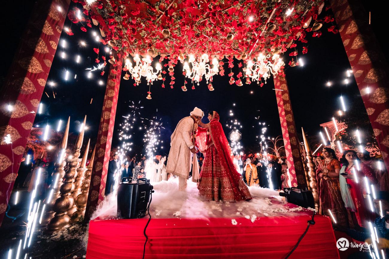Indian bride and groom exchange garlands in an ITC Grand Bharat wedding.