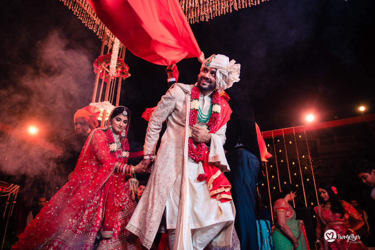 Indian bride and groom take pheras in an ITC Grand Bharat wedding.