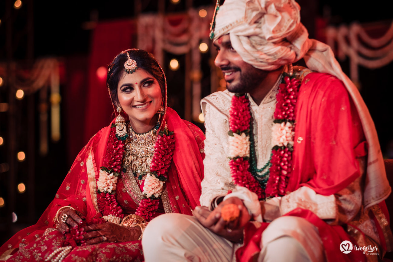 Indian bride and groom in the mandap in an ITC Grand Bharat wedding.