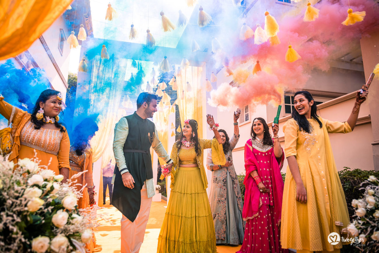 Colour bomb couple entry in an ITC Grand Bharat wedding.