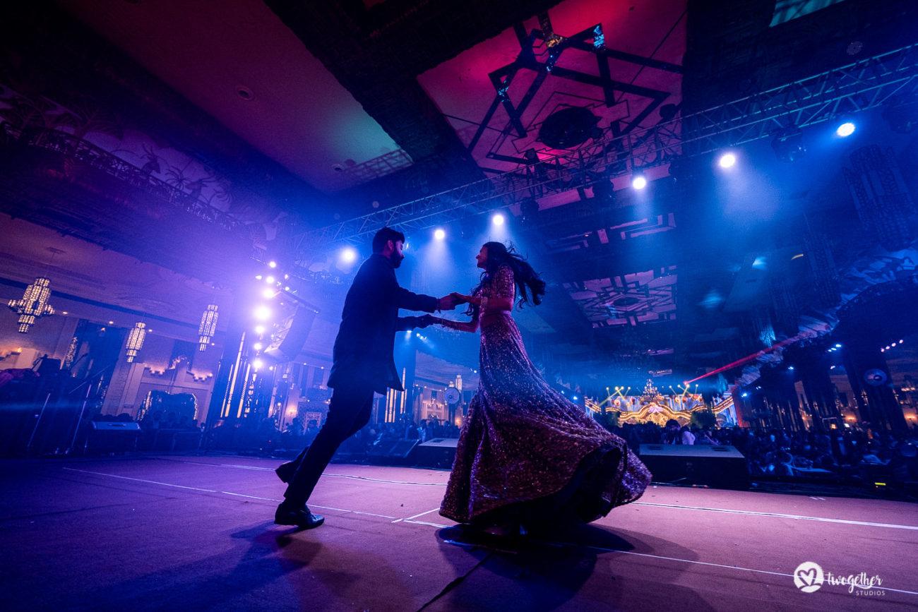 Couple dance during sangeet at their ITC Maurya wedding.
