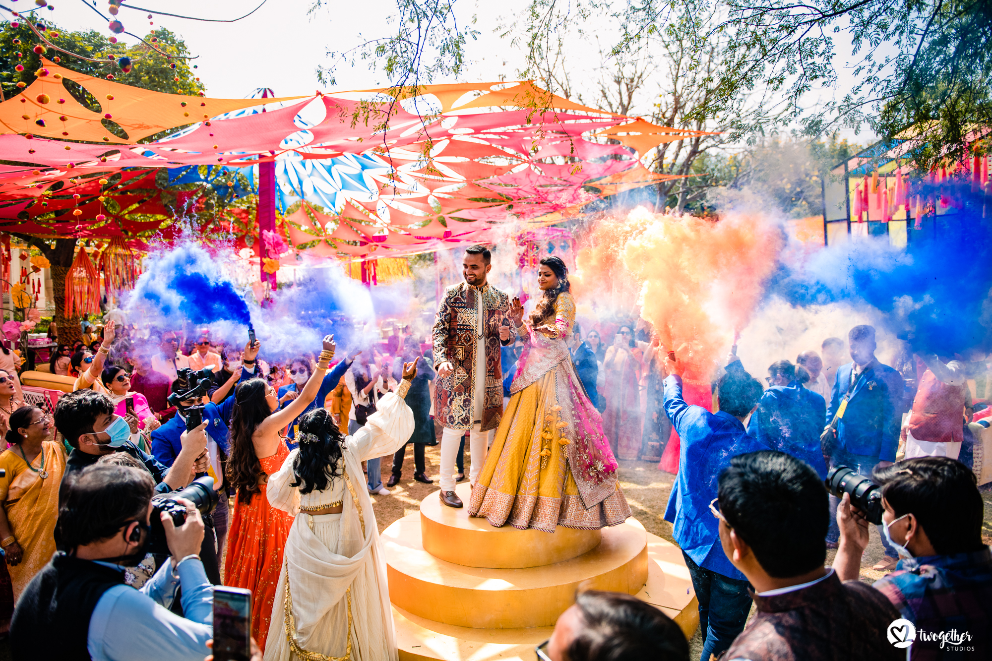 Colour couple entry at Udaipur destination wedding in Udaivilas.