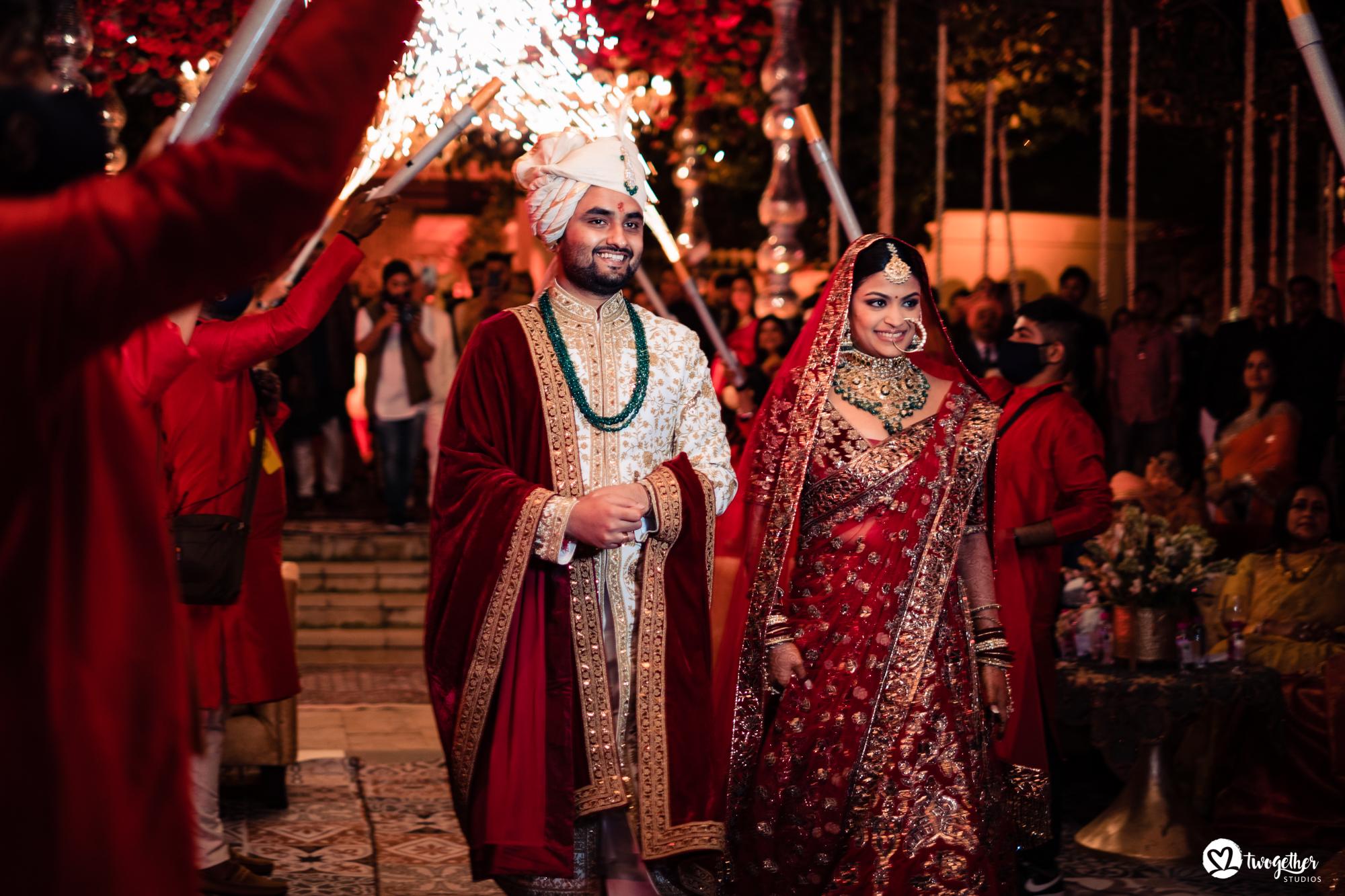 Couple entry at Udaipur destination wedding in Udaivilas.