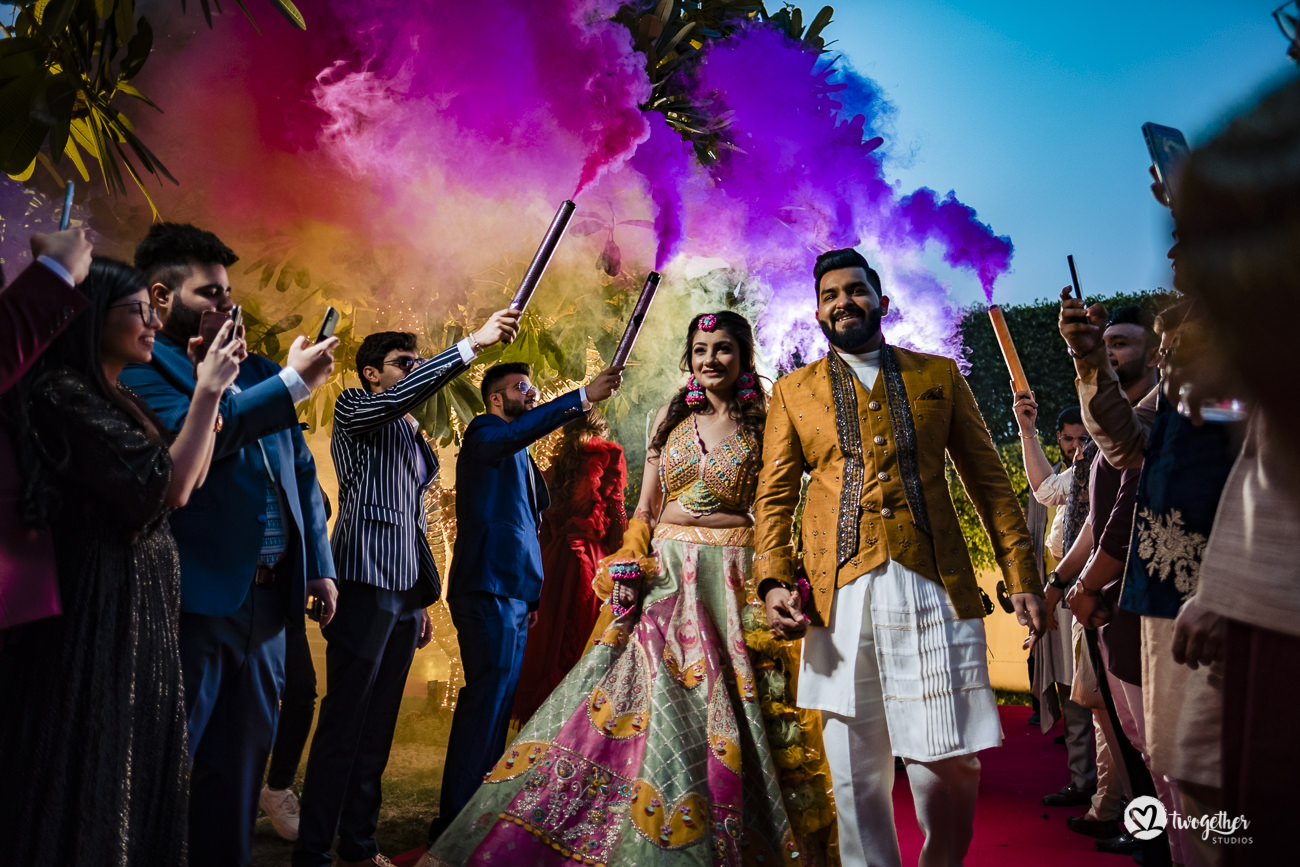 Indian couple enters their mehendi event in a Delhi wedding.